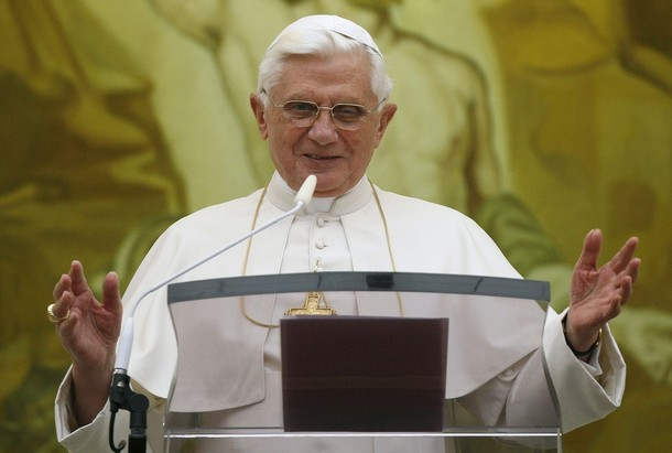 Pope Benedict XVI greets the faithful during his Sunday Angelus prayer at his summer residence of Castelgandolfo